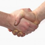 Two people meet at a workshop and shake hands