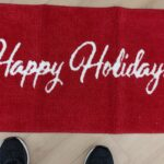 happy holidays red door mat to help step into the holiday season with warmth and confidence