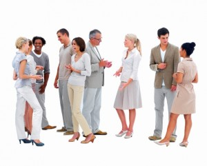 A group of people mind their posture while standing up in conversation