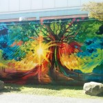 a bright art mural on the wall outside of Joe Fortes Library in the West End of Vancouver