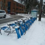 Walking past the blue public rental bicycles on a Monday in Vancouver and they are covered in freshly fallen west coast snow