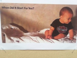 Baby on couch wearing Harley-Davidson T shirt and diapers with the text: When did it start for you?